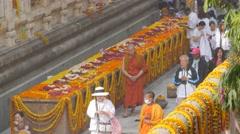 Pilgrims walking around richly decorated temple,BodhGaya,Mahabodhi Temple,India Stock Footage