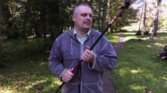 Hiker fix walking sticks.4K Stock Footage