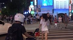 4K Asian People Walk Across The Street in Ximen distric of Night at Taipei-Dan Stock Footage