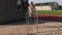 Young athlete executes strength exercises.4K Stock Footage