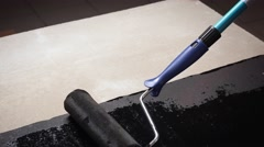 Construction roller smeared paste on the surface Stock Footage