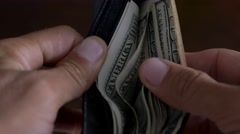 Close-up of a businessman hands counting hundred dollar bills in wallet Stock Footage