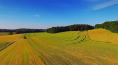 Aerial countryside rural scenery wheat field landscape farm blue sky horizon Stock Footage