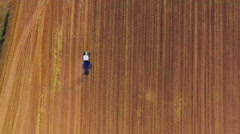 Aerial drone tractor cultivation land agriculture farming field ground texture Stock Footage