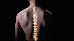 4K Illuminated spinal column projected onto the back of naked male model Stock Footage