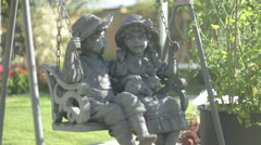 Garden Statues on a Swing Stock Footage