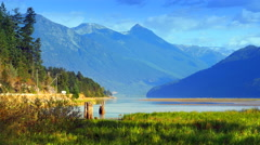 4K Mountain and River Plain Landscape, Low Setting Sun, Blue and Green Stock Footage