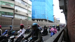 Traffic Motorbikes Driving On The Road for go work in Busy Rush-Hour Taipei -Dan Stock Footage