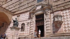 Side entrance of Perugia cathedral with Pope Julius III statue, Umbria, Italy Stock Footage