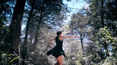 Woman dancing in forest Arkistovideo