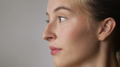 Portrait of a woman turning her face to the side and smiling -room for text Stock Footage