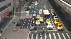 4K Aerial Traffic Cars and Motorbikes Driving On The Road Taipei City of day-Dan Stock Footage