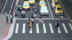 4K Aerial of Asian People Walk Across The Street in Taipei city-Dan Stock Footage