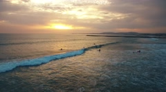 Surfers on the spot in the evening at sunset aerial view Portugal Stock Footage