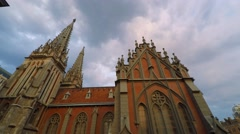 Clouds over the Gothic Catholic church, time-lapse Stock Footage