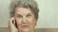 Senior woman holding smartphone talk to doctor Stock Footage