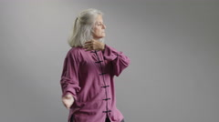 A senior aged woman doing Tai Chi Arkistovideo