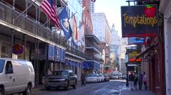 Establishing shot of Bourbon Street sign, French Quarter, New Orleans day. Stock Footage