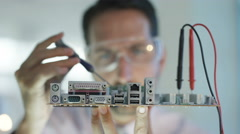 4K Close up electronics engineer working in lab building & testing motherboard Stock Footage