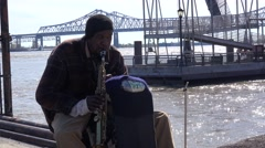 A homeless musician plays jazz music along the Mississippi River in New Orleans. Stock Footage