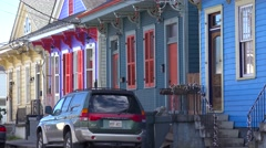 Colorful houses line a New Orleans neighborhood street. Stock Footage
