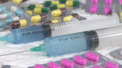 Syringe and blisters closeup Stock Footage
