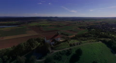 Church on the hill flying above chapel to horizon. Stock Footage