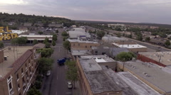 Aerial pullback shot of the historic Monte Vista Motel in downtown Flagstaff, AZ Stock Footage