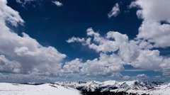 Clouds roll over the tops of the Rocky Mountains Stock Footage