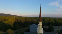 4k epic cinematic aerial of church with steeple and cross at sunest Stock Footage