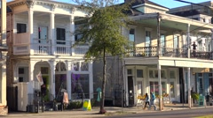 Houses and shops line a street in New Orleans, Louisiana. Stock Footage
