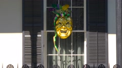 A Mardi Gras mask is displayed in a window in new Orleans. Stock Footage