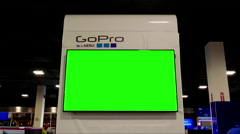 Display gopro sell items with green screen TV inside Best buy store Stock Footage