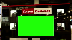 Display Canon camera for sell items with green screen TV inside Best buy store Stock Footage