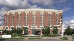 St. Joseph Medical Center Time Lapse on Clooudt Day Stock Footage