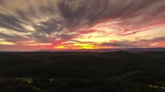 4k epic cinematic aerial over mountains with dramatic sunset Stock Footage