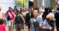 People walking on the street during rush hour in Los Angeles Downtown 4K RAW Stock Footage