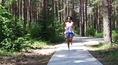 Runner woman running in forest park exercising outdoors, SLOW MOTION Stock Footage