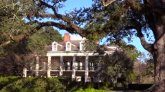 A beautiful gracious Southern mansion on an estate amongst oak trees. Stock Footage