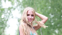 Beautiful blonde woman with long thick hair plush Stock Footage
