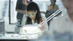 4K Electronics engineers working in lab with woman building motherboard Stock Footage