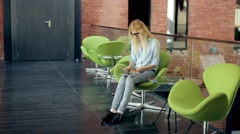 Woman Are Risen Booklets Sitting in a Chair Stock Footage