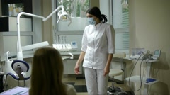 Girl comes to the dental office for treatment of a patient tooth Stock Footage