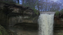 Slow-Motion shot of water tumbling down the top of Minnehaha Falls Stock Footage