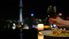 Dinner in front of Auckland city skyline at night Stock Footage