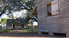 Wooden cabins used by slaves still stand on a plantation in the deep south. Stock Footage