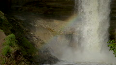 Slow-Motion shot of the bottom of Minnehaha Falls as the mist creates a rainbow Stock Footage
