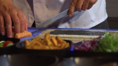 Chef cutting salmon fish for sushi Stock Footage