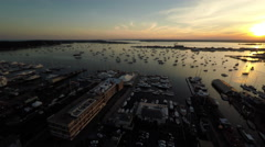 Newport RI Aerial, Newport Harbor, sunset, tracking right Stock Footage
