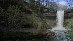 Slow-Motion, Wide-Angle of Water Tumbling Down Minnehaha Falls Stock Footage